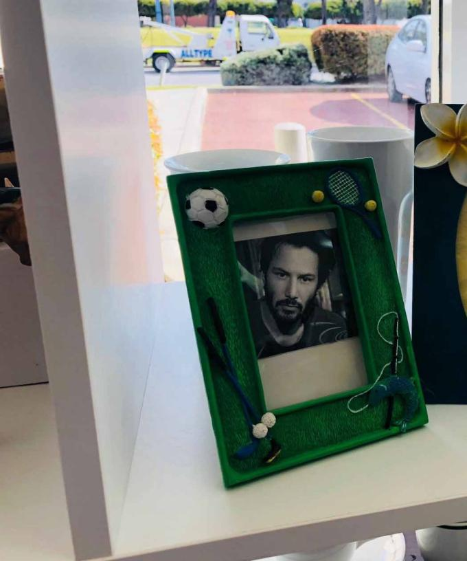 Perth Op Shop Has Keanu Reeves In All Its Picture Frames