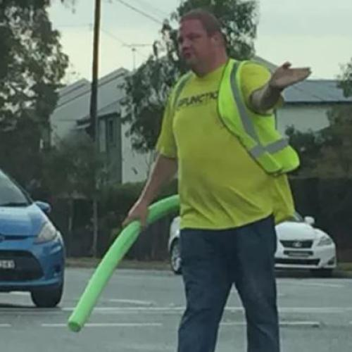 Local Legend Uses Pool Noodle To Direct Traffic During Blackout