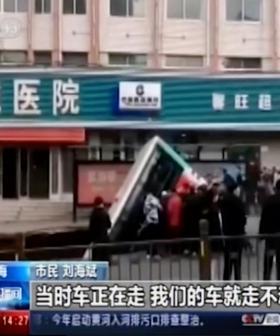 Six Dead As Sinkhole Opens On Street In China