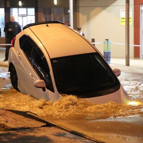Car Swallowed Up By Huge Sinkhole In Perth, Driver Escapes Unharmed