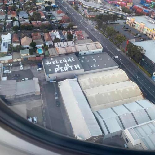 Passengers Flying Into Sydney Greeted With 'Welcome To Perth' Sign On Roof